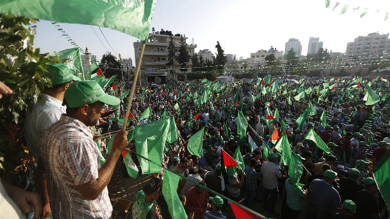 Waving Palestinian and Hamas flags, thousands rallied in Ramallah when the Gaza war ended [Reuters]