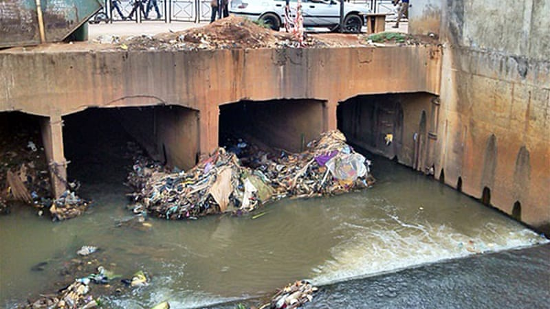 Plastic waste piles up under a bridge in the capital of Cameroon, Yaounde [Eugene Nforngwa/Al Jazeera]