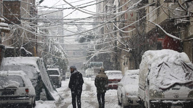 Snow stops everything for a while in Damascus [Reuters]