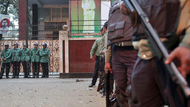 At least 100 police were stationed outside Khaleda Zia's office preventing her from leaving [AP]