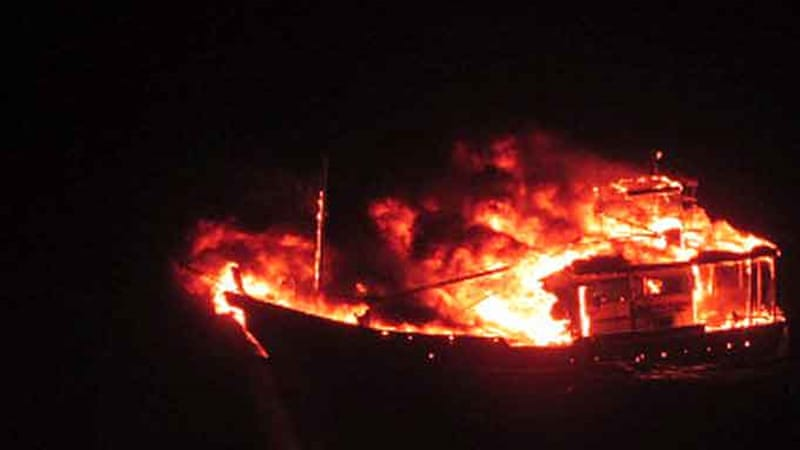India's Defence Ministry released images purportedly showing the boat after the explosion on board [AFP]