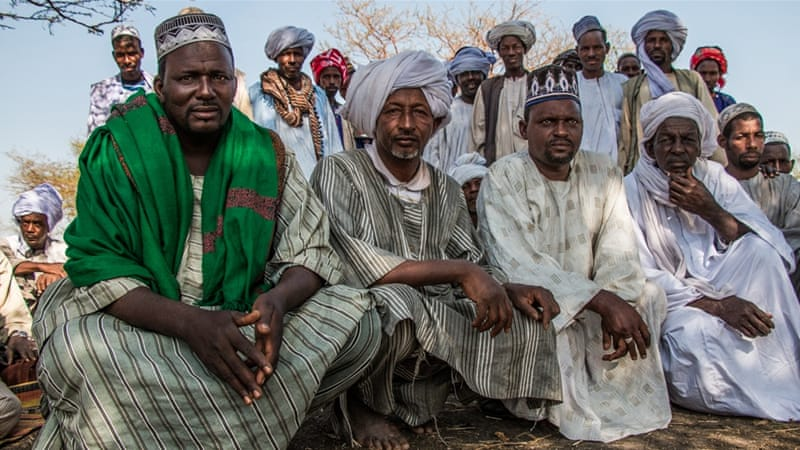 paramount chief ahmed omar younis wearing a green scarf with falata