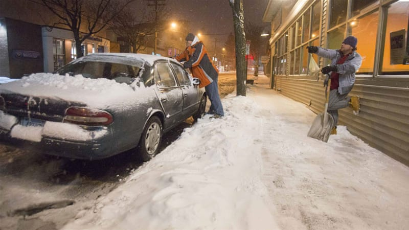 A massive, wind-whipped blizzard slammed into the US Northeast on Monday, shutting down much of New York City [Reuters]