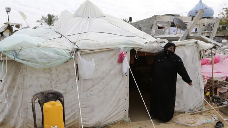 Tens of thousands of Palestinians in Gaza remain homeless since Israel destroyed their homes last summer [Reuters]