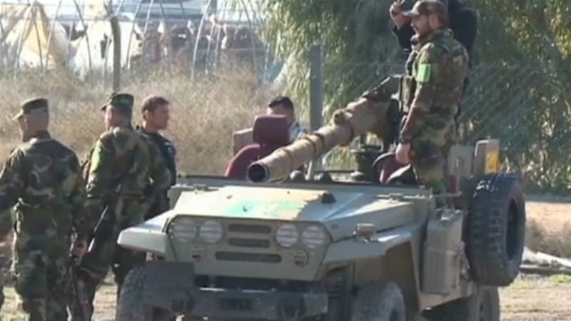 Witnesses told Al Jazeera that Shia armed men and Iraqi forces rounded up men in the Sunni village of Barwana [Reuters]
