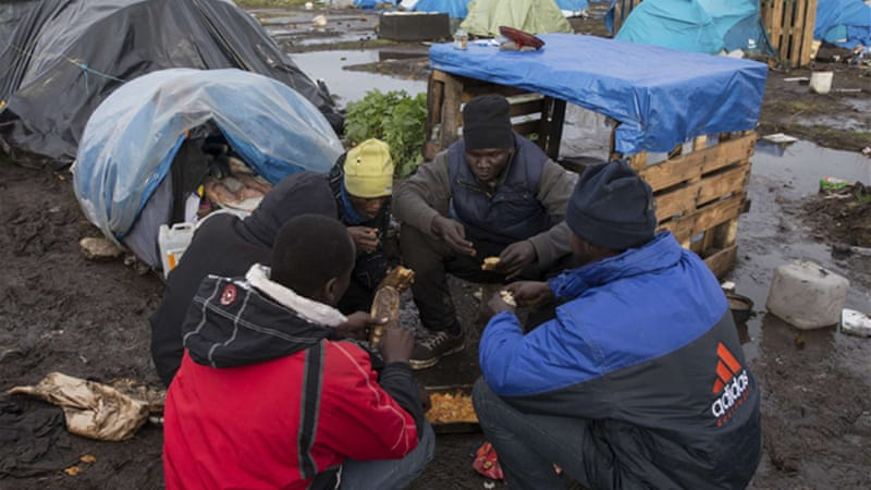 About 2,300 migrants live in a makeshift tent village known as 'the jungle' in Calais [Reuters]