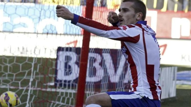 Target man: 23-year-old Griezmann has scored five goals in his last two games for Atletico [EPA]