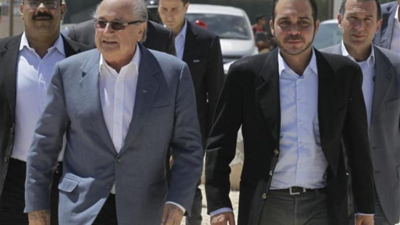 Blatter, left, and Prince Ali visit a refugee camp in Jordan in 2013. Prince Ali is set to challenge the Swiss in May [AFP]