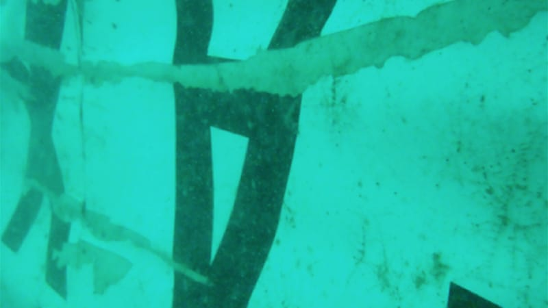 "AirAsia's logo, an upside down ""A"", was seen on a piece of metal at the site in the Java sea [AP]"