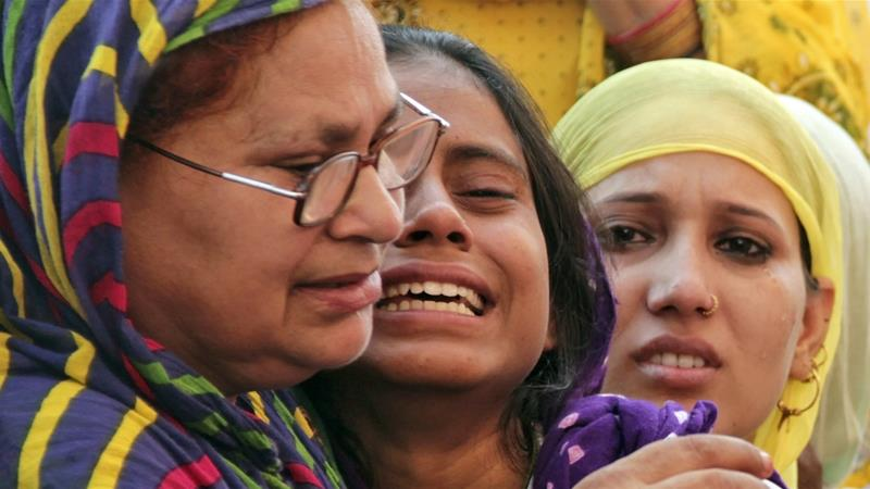 Relatives of Mohammad Akhlaq mourn the day after he was killed by a mob on September 28, 2015 [Reuters]