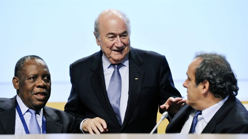 Blatter (c) and Platini (r) have been suspended for 90 days [AP]