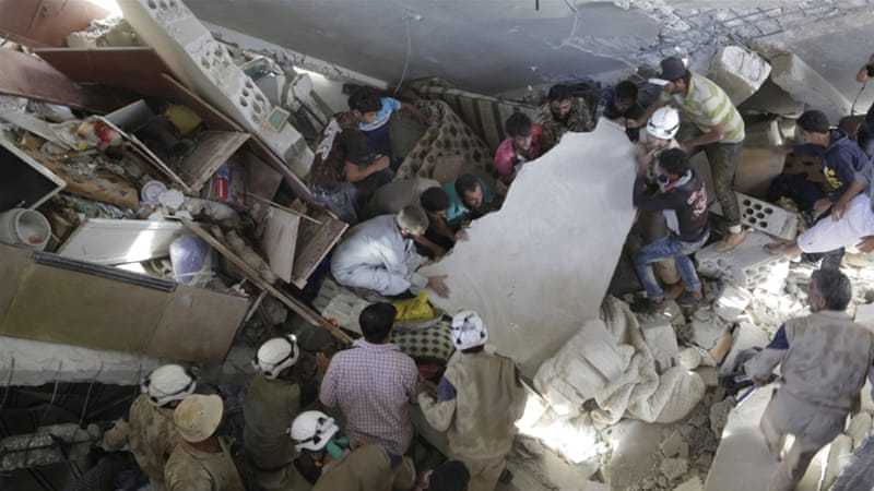 Civil defense search for survivors under the rubble of a site reportedly hit by cluster bombs dropped by Russian warplanes in Idlib [Reuters]