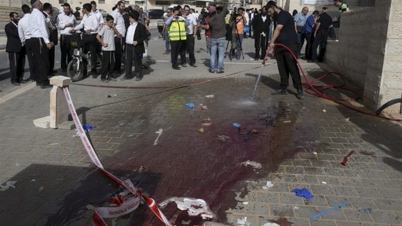 Israeli police shot two Palestinians who witnesses said tried to stab an Israeli [Baz Ratner/Reuters]