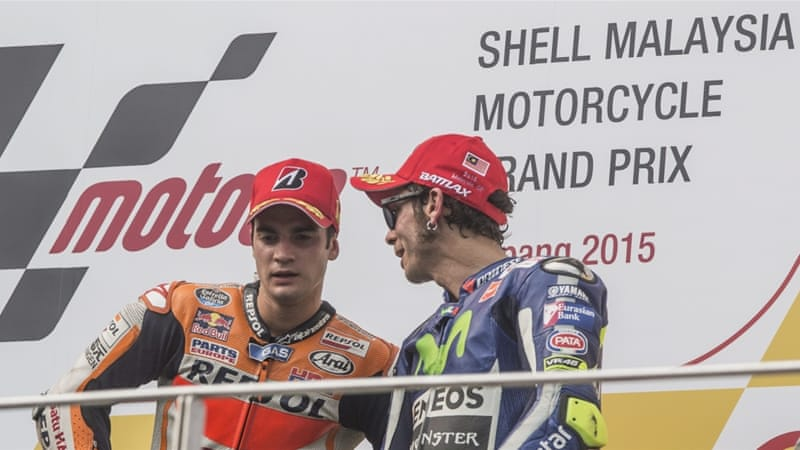 Rossi (R) is seven points clear of Pedrosa's team mate Lorenzo [EPA]