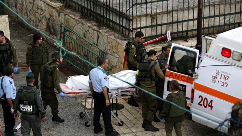 A 16-year-old Palestinian girl in the West Bank city of Hebron was shot dead after allegedly trying to stab an Israeli policeman on Sunday [EPA]