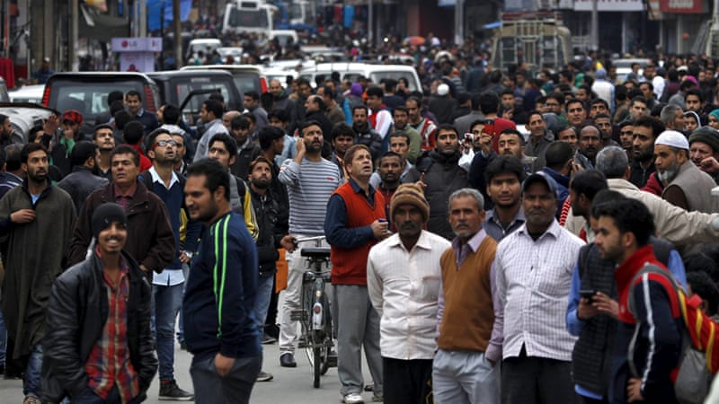 People pour out of offices into a street in India's Kashmir after a  strong quake hit the region / Al Jazeera And Agencies