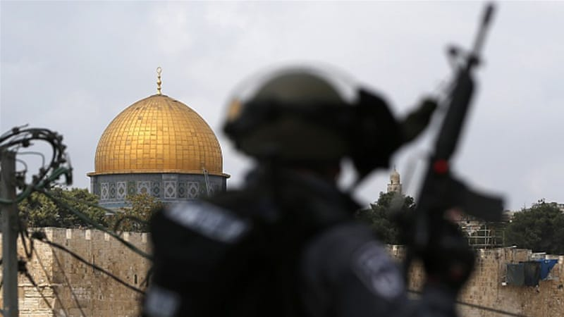 Israeli security forces stand guard as Palestinian Muslims take part in Friday prayers in occupied East Jerusalem [Getty]