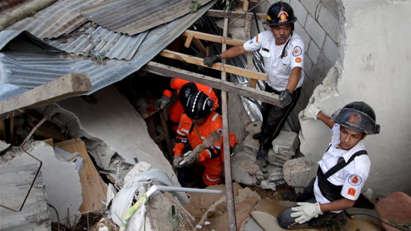 Scores of rescue workers laboured through dusk to recover bodies from the tangle of mangled walls, beds and furniture [Reuters]