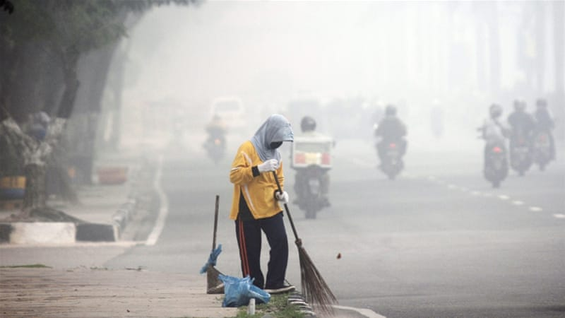 More than 140,000 people have reported respiratory infections in Indonesia [EPA]