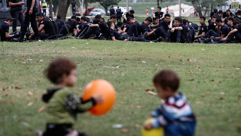 Syrian refugee children play in the foreground near Turkey's western border with Greece and Bulgaria [Emrah Gurel/AP]