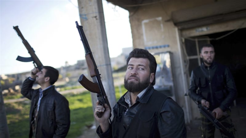 Free Syrian Army fighters look at a Syrian Army jet in 2012, north of Aleppo province [AP]