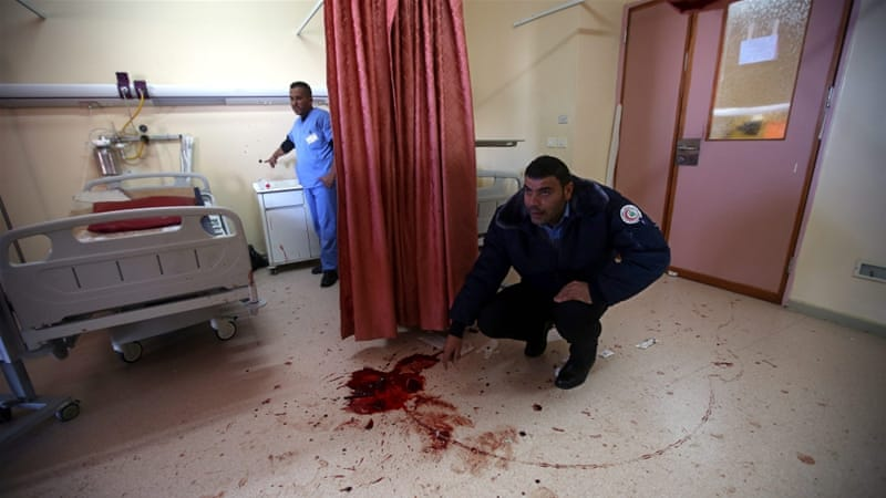 Israeli forces shot Abdullah al-Shalaldeh multiple times in the process of arresting his cousin Azzam at a Hebron hospital [EPA]