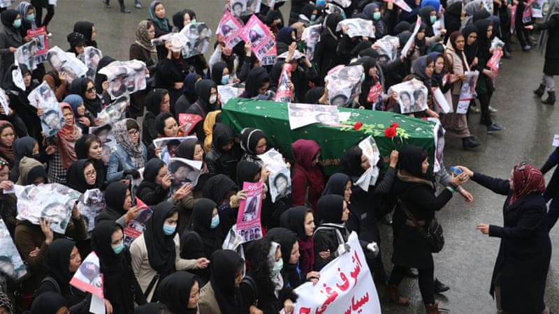 Afghan women carry the coffin of a nine-year-old girl as thousands march in the Afghan capital of Kabul on Wednesday [AP]