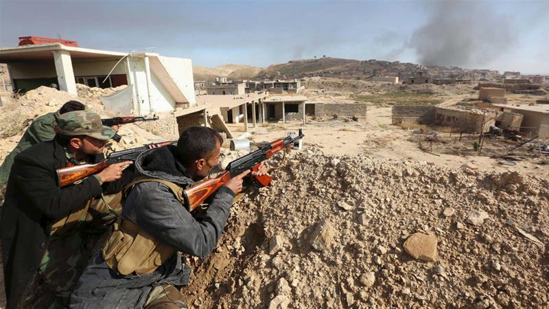 The offensive in Sinjar has cut off the ISIL's supply lines between their strongholds of Mosul in Iraq and Raqqa in Syria [Ari Jalal/Reuters]