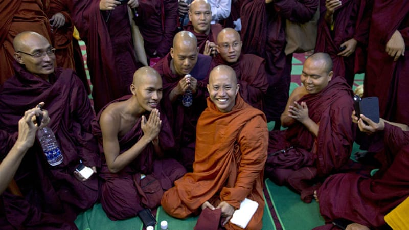 File: Wirathu, pictured in the centre, is known for his controversial statements against Muslims [Gemunu Amarasinghe/AP]