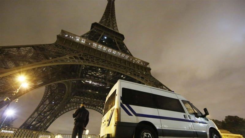 A police officer stands guard at the foot of the Eiffel Tower in Paris [EPA]