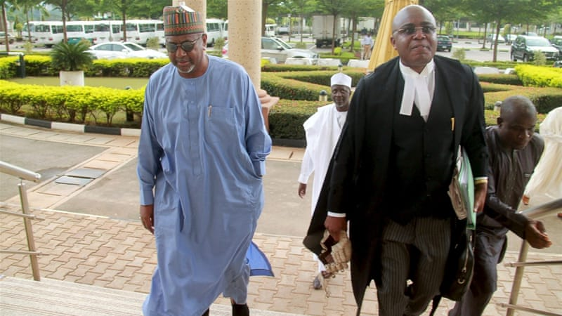Sambo Dasuki (left) stands accused of awarding 'phantom' military contracts worth $2bn [Reuters]