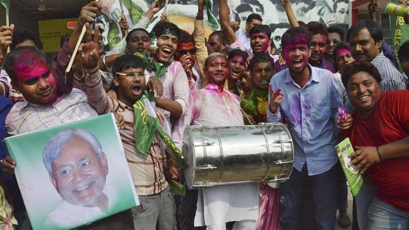 Supporters of the Janata Dal [United] party celebrate the election results at their party office in Patna, Bihar [Reuters]