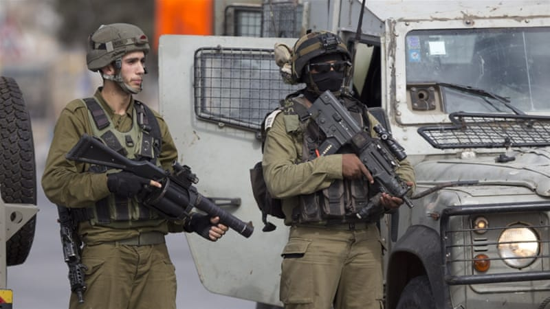 Israeli security forces stand guard at a checkpoint near Jenin [File: Majdi Mohammed/AP]