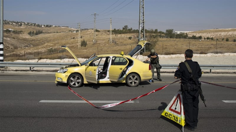 Israeli police at the scene where a Palestinian allegedly tried to run over civilians [Abir Sultan/EPA]