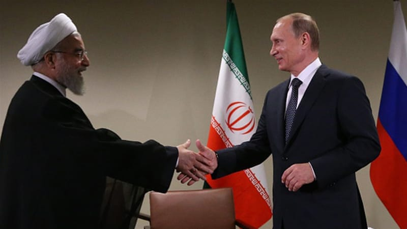 Putin greets Rouhani during their bilateral meeting at the UN on September 28, 2015 in New York [Getty]