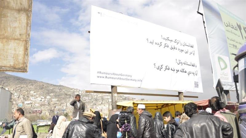 The billboard erected in Kabul reads 'Leaving Afghanistan? Are you sure?' in Dari and Pashto, the two main languages of Afghanistan [Fatima Faizi/Al Jazeera]