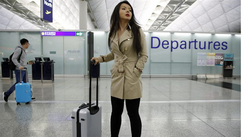 Canada's Miss World contestant Anastasia Lin poses for photographers after she was denied entry to mainland China [Kin Cheung/AP]