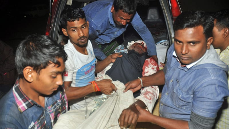 A man wounded in an attack on a Shia mosque is carried for treatment in Bogra district on Thursday [AP]