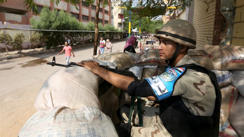 Four police were attacked by masked gunmen in Giza on Saturday [Mohamed Abd El Ghany/Reuters]