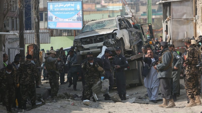 Afghan security forces inspect the site of a suicide attack in Kabul, Afghanistan (Rahmat Gul/AP Photo)