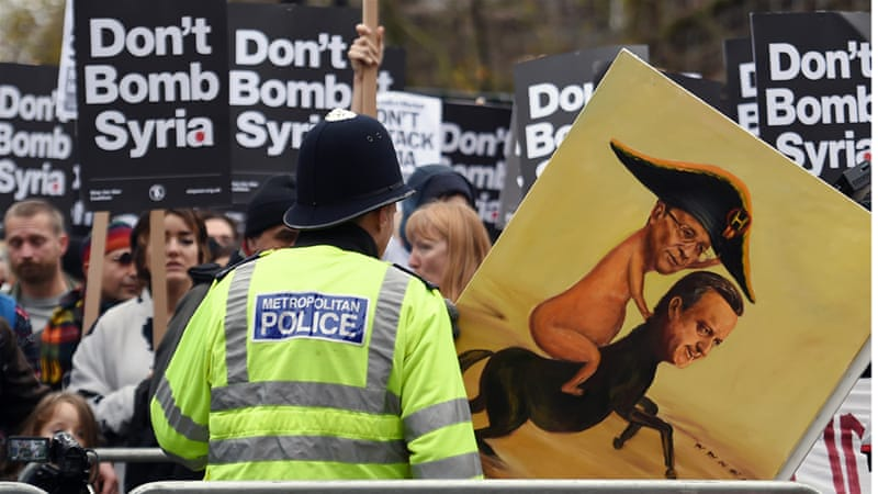 Demonstrators protest against British bombing of Syria outside Downing Street in London on Saturday [Andy Rain/EPA]