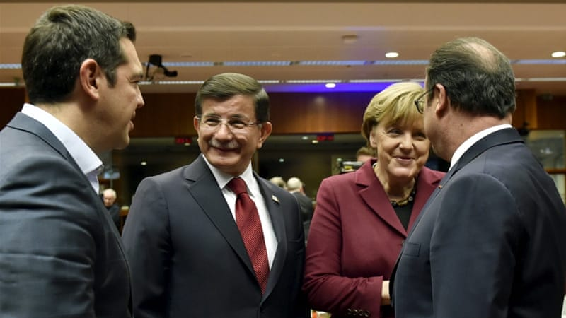 Tsipras and Davutoglu talk to German Chancellor Merkel and French President Hollande at the Brussels summit [Eric Vidal/Reuters]