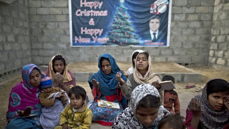 Pakistani Christians pray in a makeshift church in a slum on the outskirts of Islamabad, Pakistan [Muhammed Muheisen/AP]