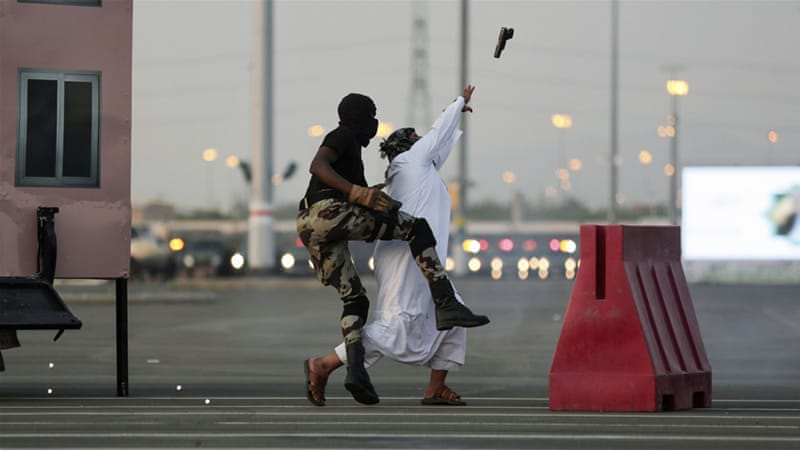 Saudi security forces show their skills in handling a 'terrorist' attack as part of military exercises [Mosaab Elshamy/AP]