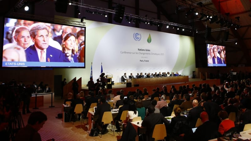 US Secretary of State John Kerry appears on television screens during the final conference at the COP21 [AP]