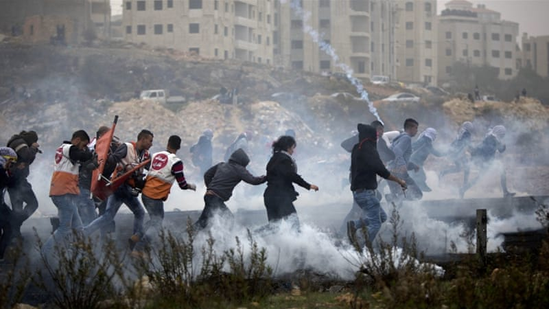 Clashes between Palestinian residents and Israeli forces broke out after soldiers entered the Qalandiya camp [File: Majdi Mohammed/AP]