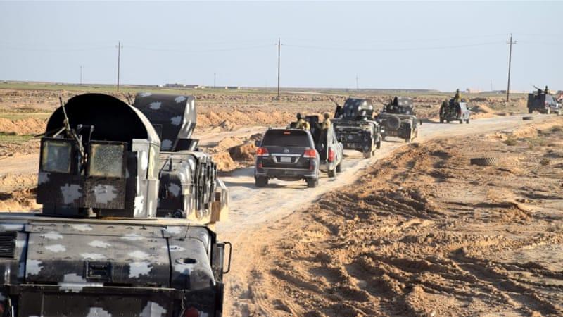 Iraqi military trucks advancing into an area in eastern Ramadi city on December 2 [EPA]