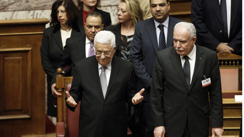 Palestinian President Mahmoud Abbas acknowledges applause by Greek politicians on Tuesday [Michalis Karagiannis/Reuters]