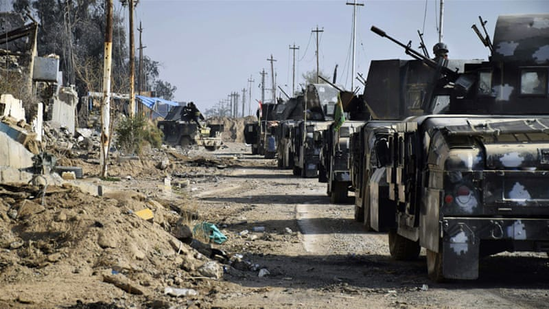 Iraqi security forces enter heavily damaged Ramadi, 115km west of Baghdad [Rwa Faisal/AP]