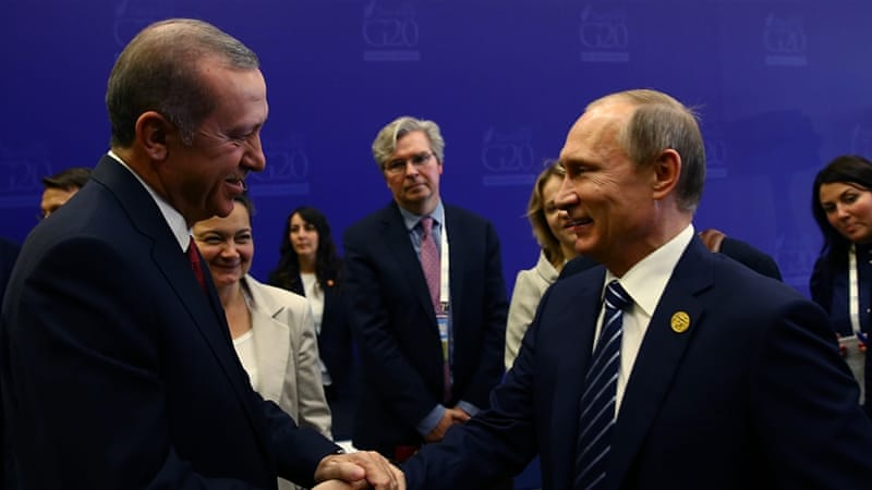 Erdogan shakes hands with Putin at the end of the G-20 Summit in Antalya, Turkey, on November 16 [AP]